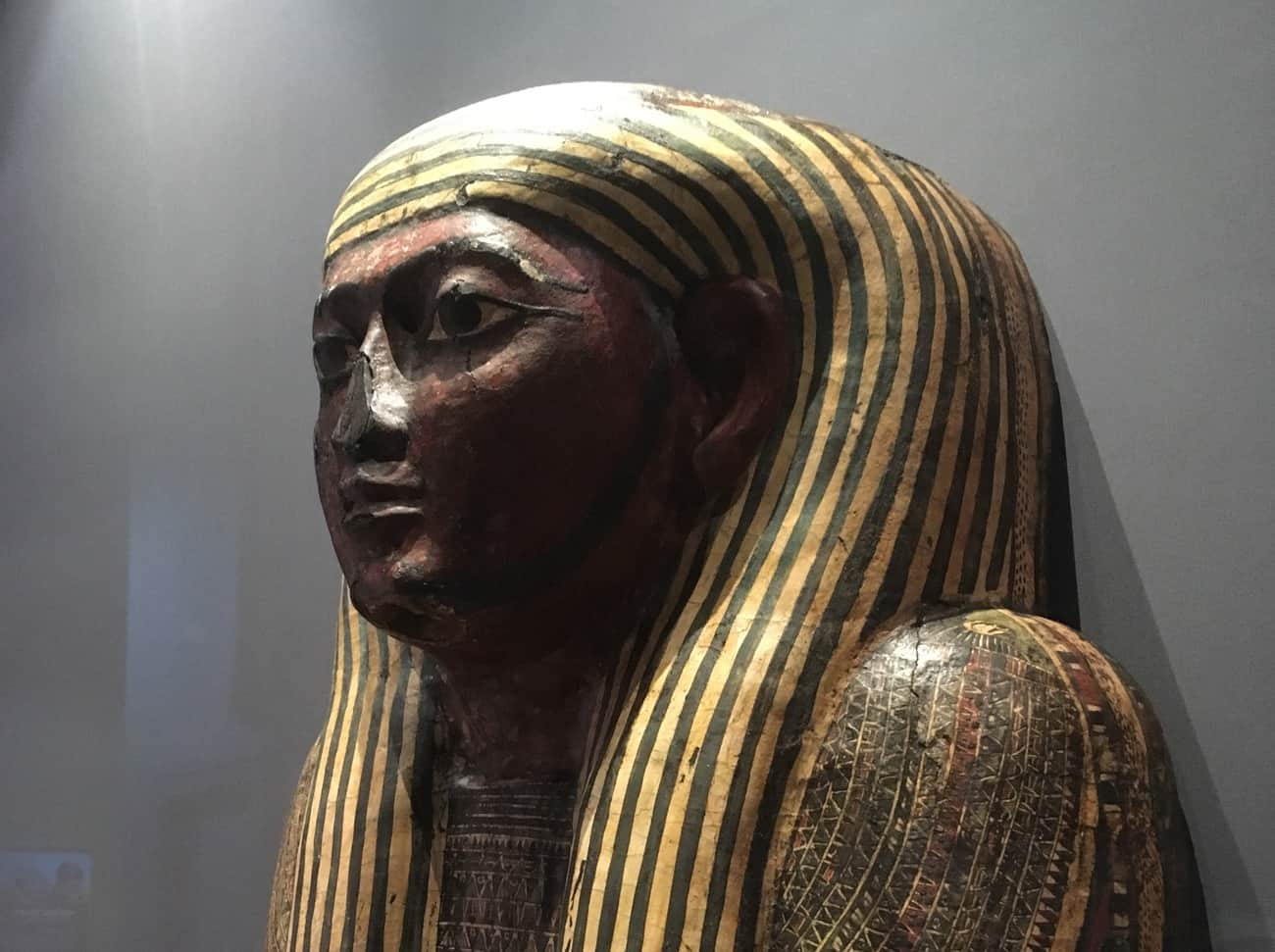 Close up of the head section of an Egyptian coffin on display at the World Museum in Liverpool